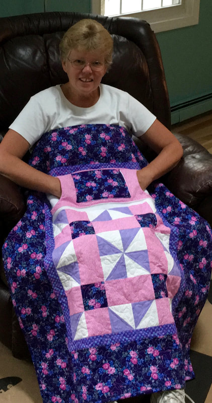 Purple and Pink Lovie Lap Quilt with Pockets from http://www.HomeSewnByCarolyn.com