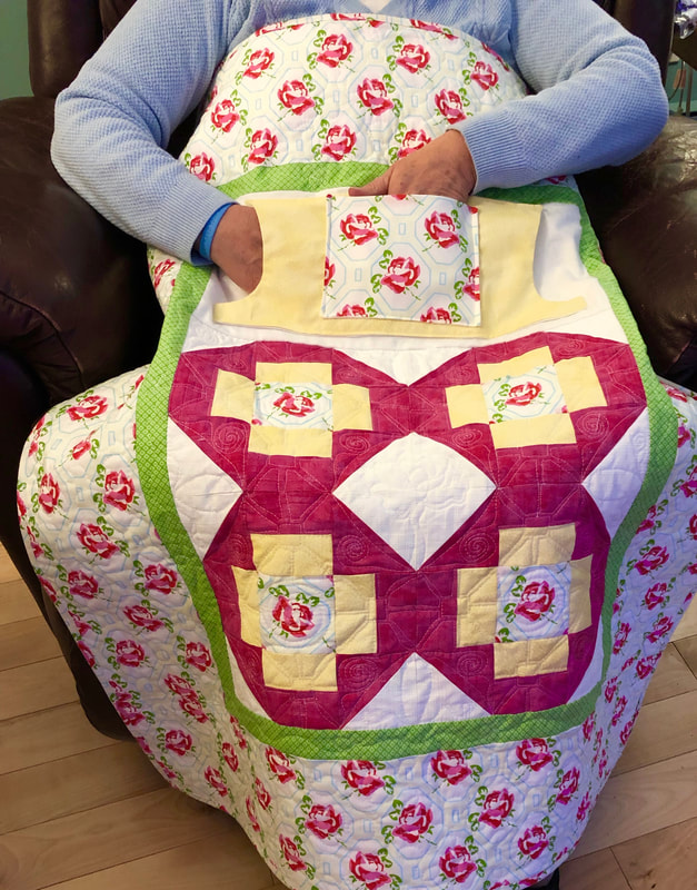 Pink Roses Lovie Lap Quilt with Pockets from http://www.HomeSewnByCarolyn.com/lovie-lap-quilts.html