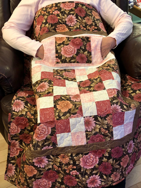 Pink and Brown Floral Lovie Lap Quilt with Pockets for sale from http://www.HomeSewnByCarolyn.com
