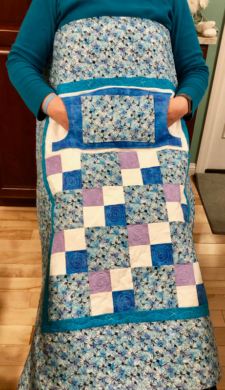 Blue Daisy Lovie Lap Quilt with Pockets for sale from http://www.HomeSewnByCarolyn.com