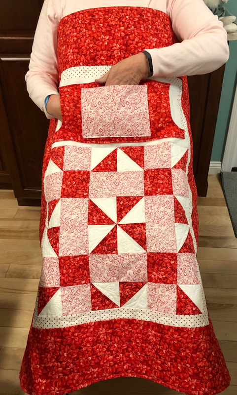 Red and White Lovie Lap Quilt with Pockets from http://www.HomeSewnByCarolyn.com