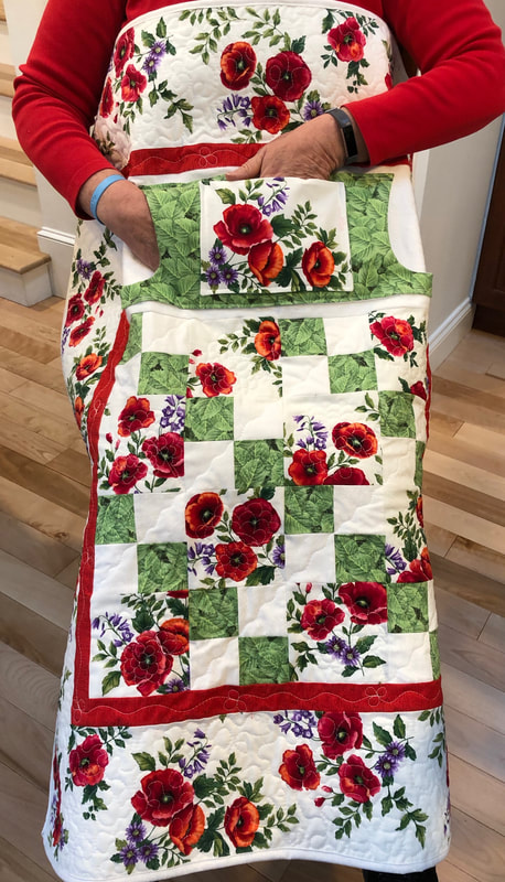 Wheelchair lap quilt with pockets for sale from http://www.HomeSewnByCarolyn.com