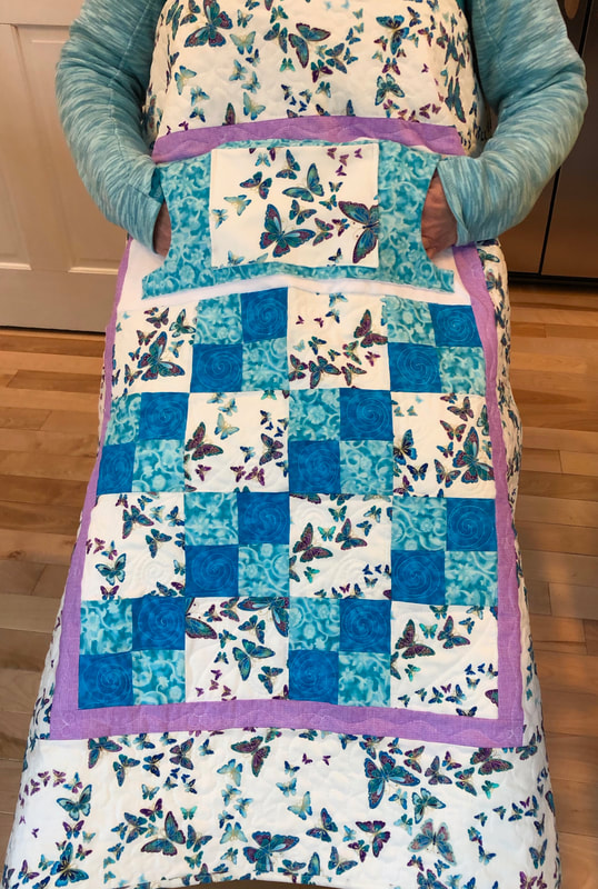Butterfly Lovie Lap Quilt with Pockets in teal and blue for sale from http://www.HomeSewnByCarolyn.com