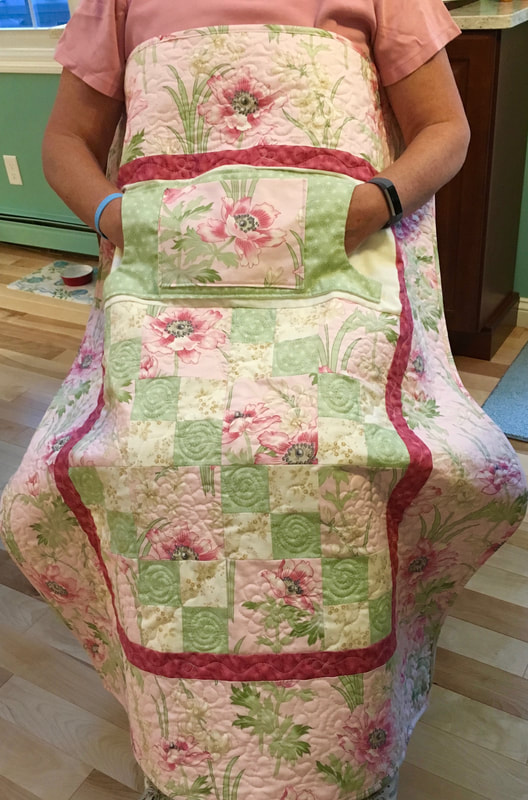 Pink Floral Lovie Lap Quilt with Pockets makes a great Mother's Day Gift for sale from http://www.HomeSEwnByCarolyn.com
