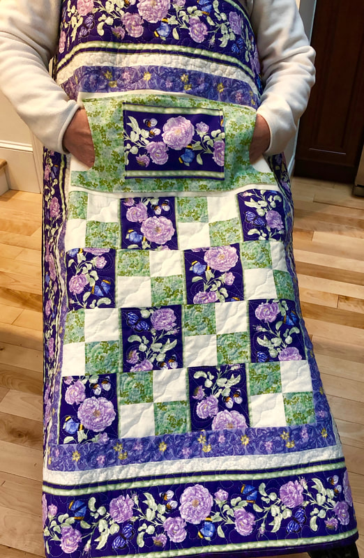 Purple Floral Lovie Lap Quilt with Pockets, great wheelchair quilt, for sale from http://www.HomeSewnByCarolyn.com
