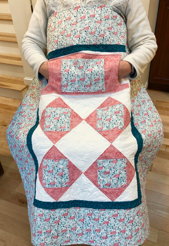 Pink Flamingo Lovie Lap Quilt with Pockets from http://www.HomeSewnByCarolyn.com/lovie-lap-quilts.html
