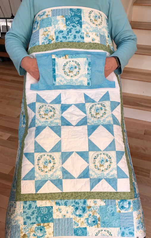 Teal Floral Lovie Lap Quilt with Pockets, wheelchair quilt for sale from http://www.HomeSewnByCarolyn.com/lovie-lap-quilts.html