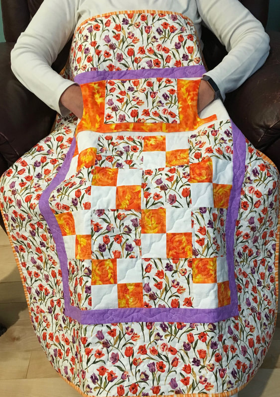Tiny Tulips Lovie Lap Quilt with Pockets from http://www.HomeSewnByCarolyn.com