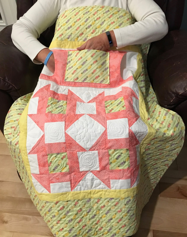 Churn Dash Lovie Lap Quilt with Pockets from http://www.HomeSewnByCarolyn.com