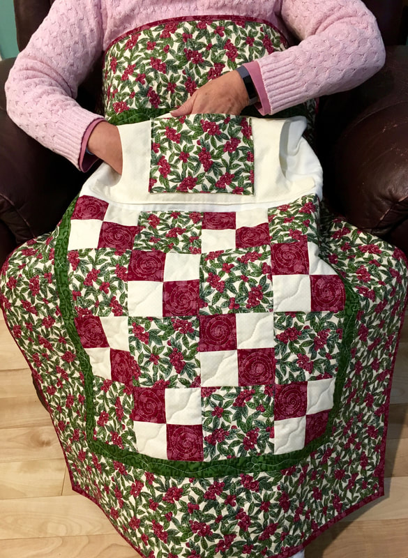 Cranberry Lovie Lap Quilt with Pockets from http://www.HomeSewnByCarolyn.com