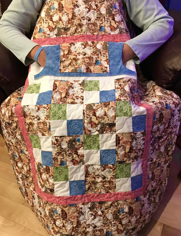 Kitten Lovie Lap Quilt with Pockets from http://www.HomeSewnByCarolyn.com
