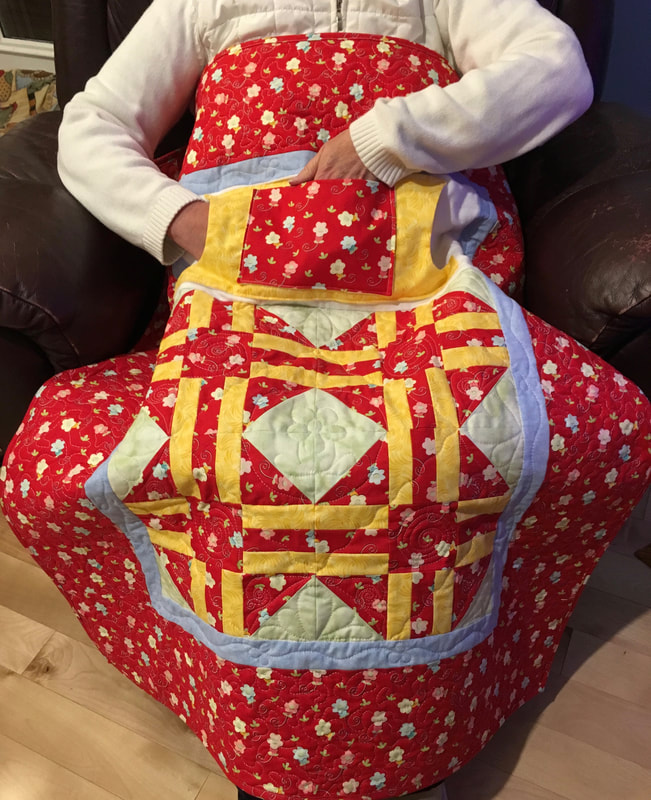 Red and Yellow Lovie Lap Quilt with Pockets from http://www.HomeSewnByCarolyn.com