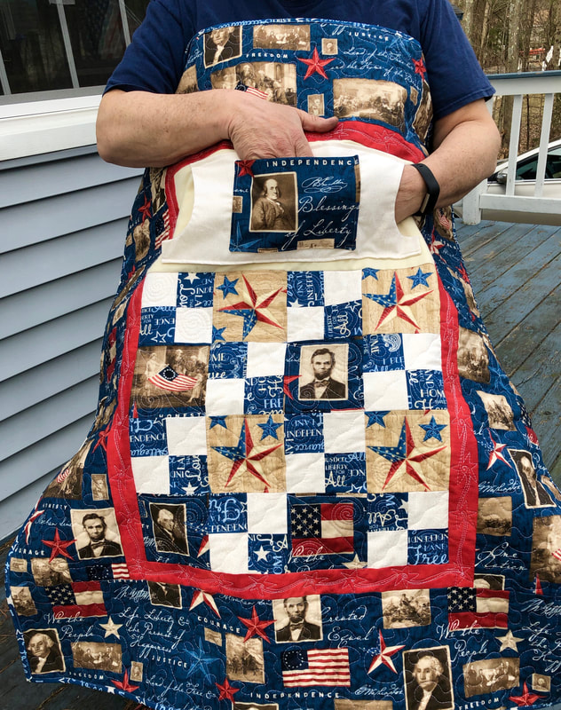 Liberty Lovie Lap Quilt with Pockets for sale from http://www.HomeSewnByCarolyn.com  Wheelchair lap quilt for Dad or Grandpa!