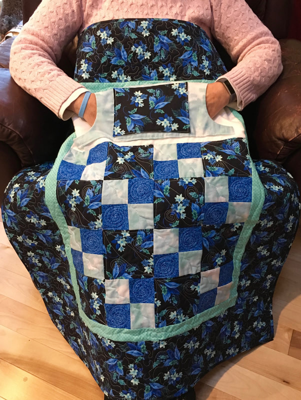 Blue Floral Lovie Lap Quilt with Pockets from http\www.HomeSewnByCarolyn.com