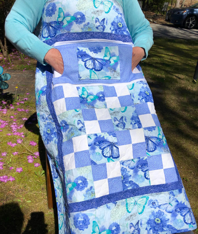 Periwinkle Lovie Lap Quilt with Pockets for sale at http://www.HomeSewnByCarolyn.com