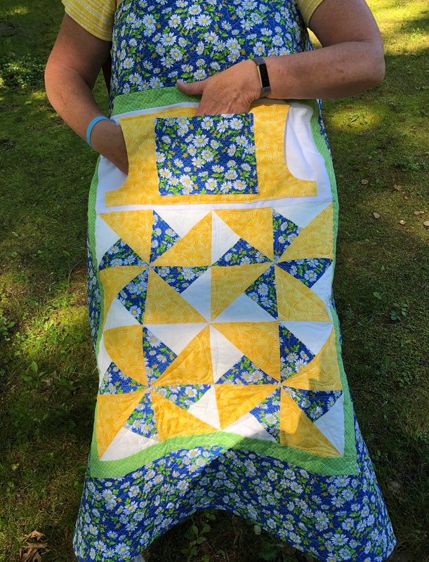 White Daisy Lovie Lap Quilt with Pockets for sale from http://www.HomeSewnByCarolyn.com  Wheelchair lap quilts