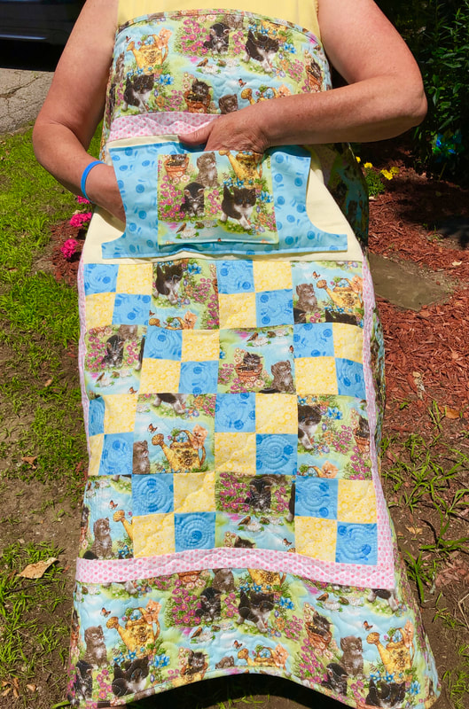 Wheelchair lap quilt with pockets and adorable kitten fabric for sale from http://www.HomeSewnByCarolyn.com/lovie-lap-quilts.html