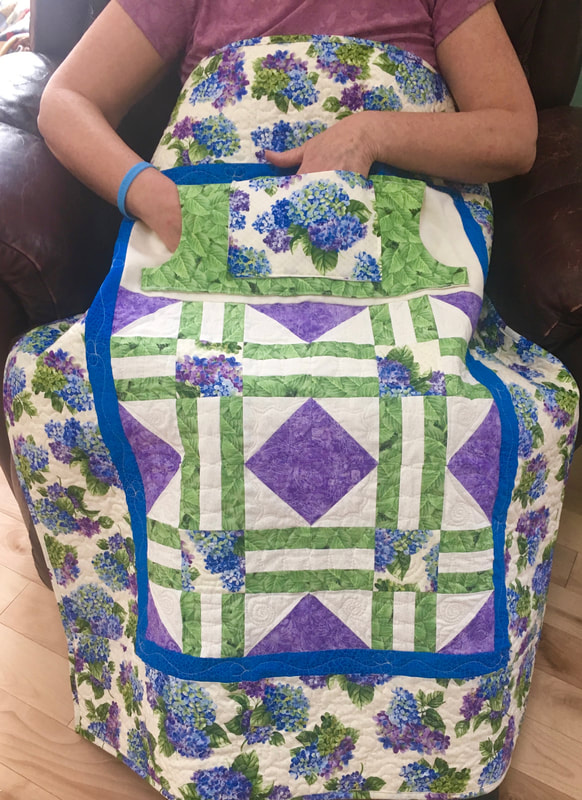 Hydrangea Lovie Lap Quilt with Pockets for sale from http://www.HomeSewnByCaorlyn.com  Great Mother's Day gifts.