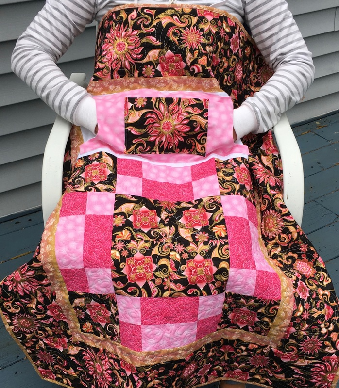 Kaleidoscope Lovie Lap Quilt with Pockets from http://www.HomeSewnByCarolyn.com