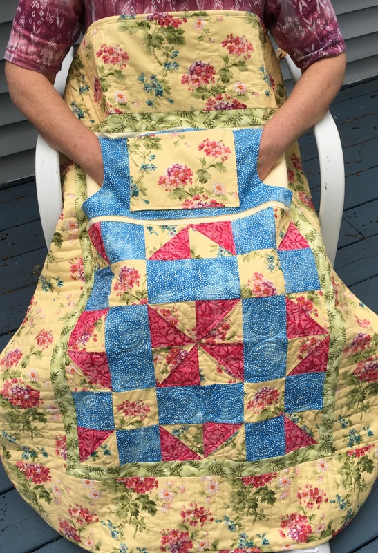 Small Floral Lovie Lap Quilt with Pockets from http://www.HomeSewnByCarolyn.com