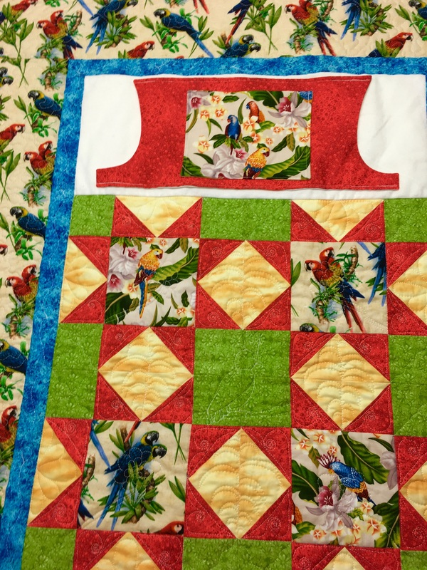 Parrot Lovie Lap Quilt from http://www.HomeSewnByCarolyn.com