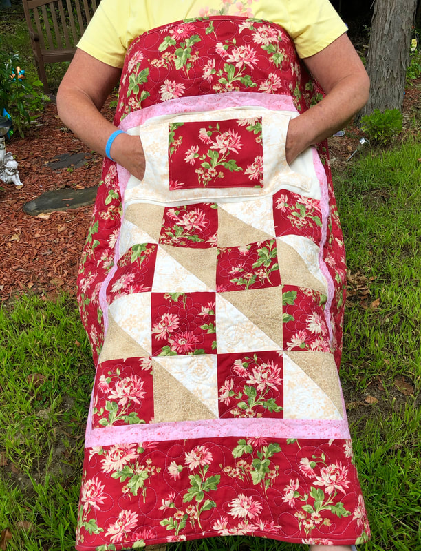 Chrysanthemum Lovie Lap Quilt with Pockets, for sale from http://www.HomeSEwnByCarolyn.com/lovie-lap-quilts.html