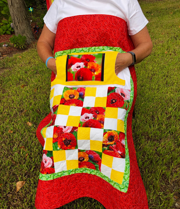 Poppies Lovie Lap Quilt with Pockets, wheelchair lap quilt for sale from http://www.HomeSewnByCarolyn.com/lovie-lap-quilts.html