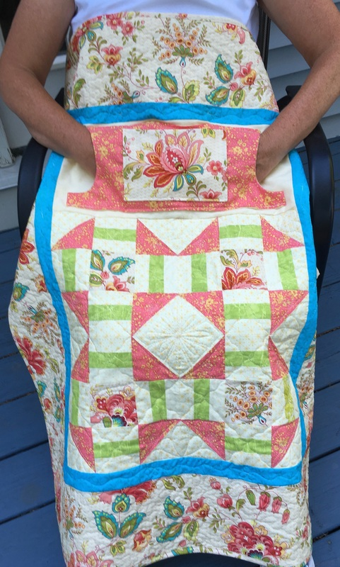 Peach Floral Lovie Lap Quilt with Pockets from http://www.HomeSewnByCarolyn.com