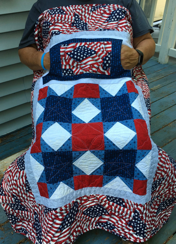 Patriotic Lovie Lap Quilt with Pockets from http://www.HomeSewnByCarolyn.com