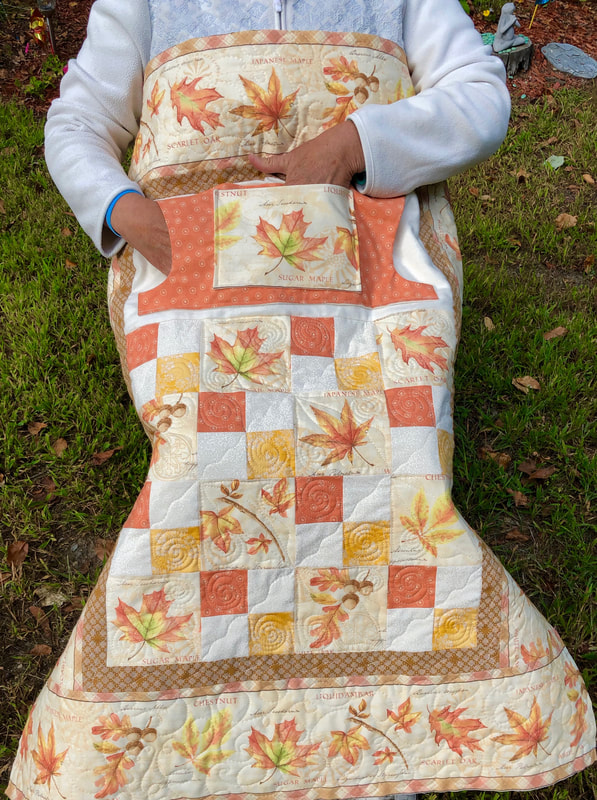 Autumn Leaves Lovie Lap Quilt with Pockets for sale from http://www.HomeSewnByCarolyn.com/lovie-lap-quilts.html