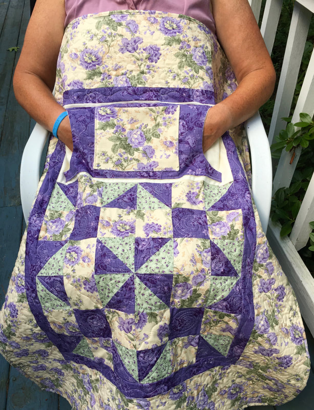 Lavender Floral Lovie Lap Quilt with Pockets from http://www.HomeSewnByCarolyn.com