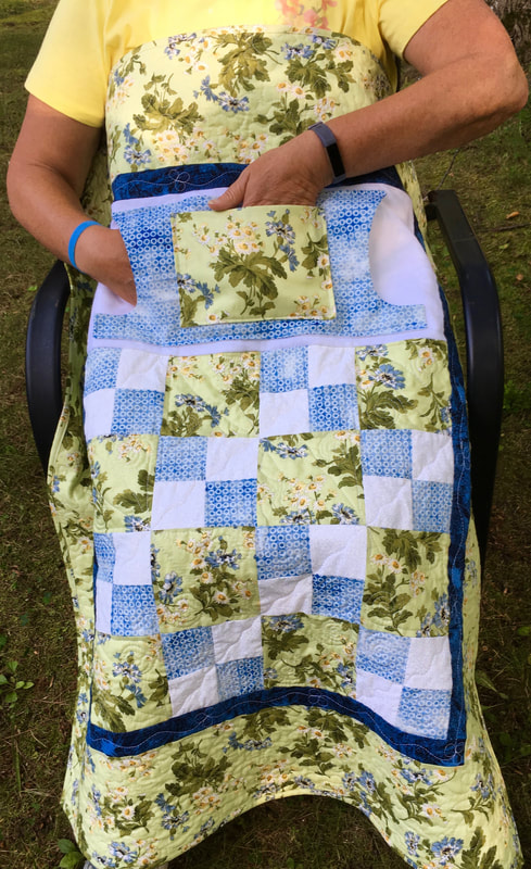 Green and Blue Floral Lovie Lap Quilt with Pockets from http:///www.HomeSewnByCarolyn.com  Great for wheelchairs.