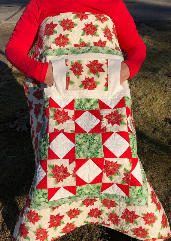 Poinsettia Lap Quilt with Pockets for sale from http://www.HomeSEwnByCarolyn.com/lovie-lap-quilts.html