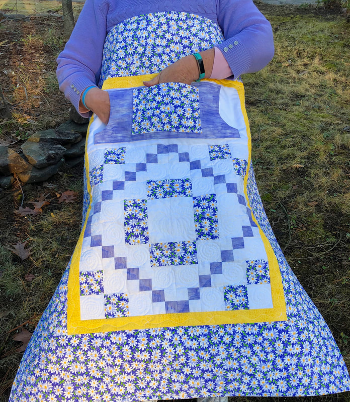 Pocket Lap Quilt, Lilac with White Daisies for sale from http://www.HomeSewnByCarolyn.com/lovie-lap-quilts.html