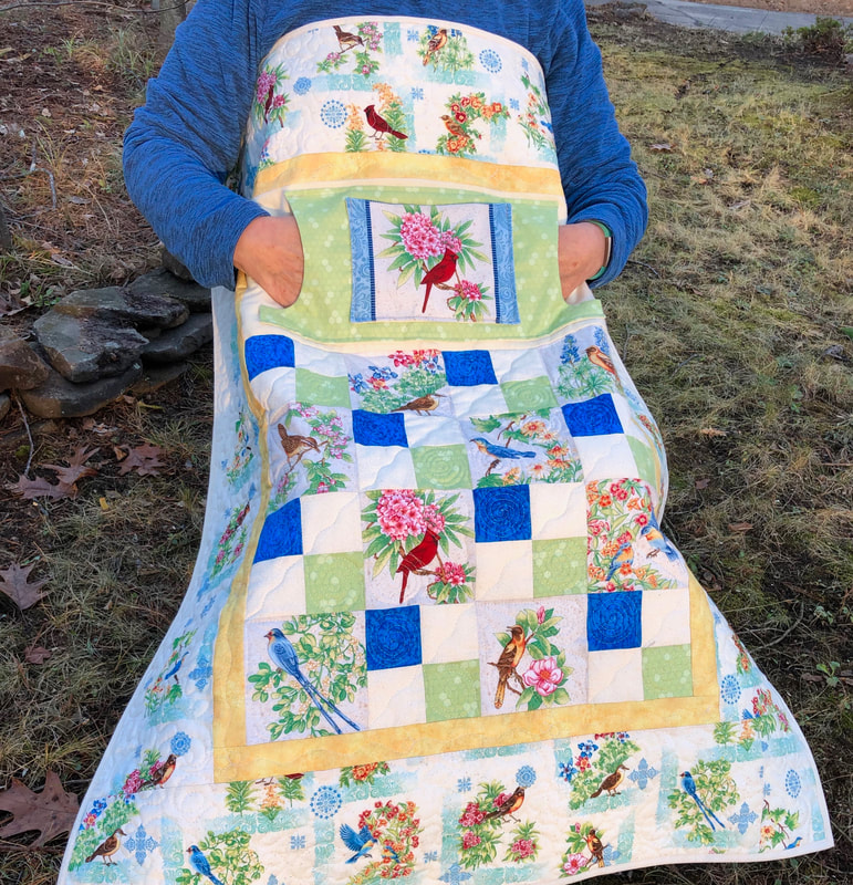 Beautiful Birds Lovie Lap Quilt with Pockets for sale from http://www.HomeSewnByCarolyn.com/lovie-lap-quilts.html