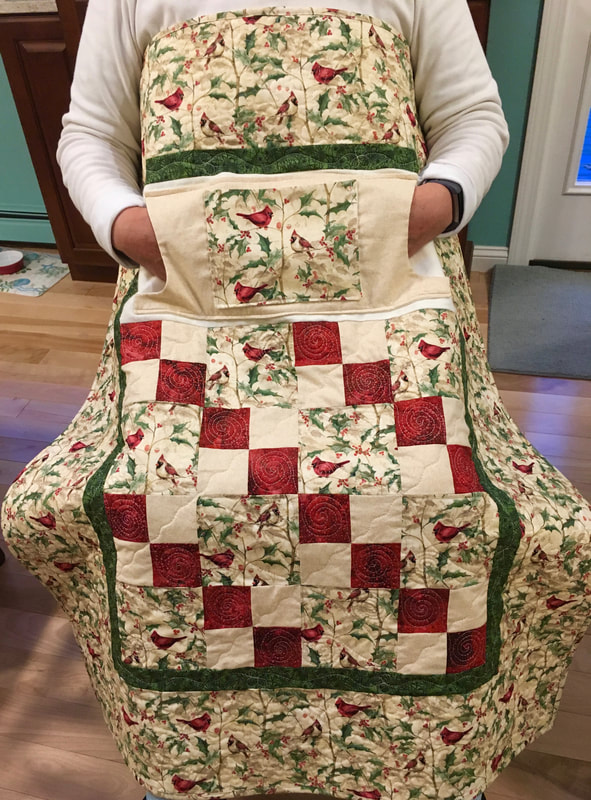 Cardinal Lovie Lap Quilt with Pockets from http://www.HomeSewnByCarolyn.com