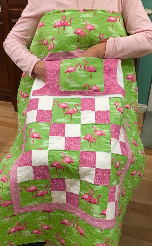 Pink Flamingo Lap Quilt with Pockets for sale from http://www.HomeSewnByCarolyn.com