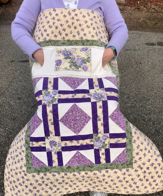 Wheelchair lap quilt with pockets to keep your hands warm.  For sale from http://www.HomeSewnByCarolyn.com