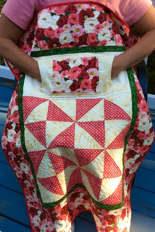 Red Roses Lovie Lap Quilt with Pockets from http://www.HomeSewnByCarolyn.com
