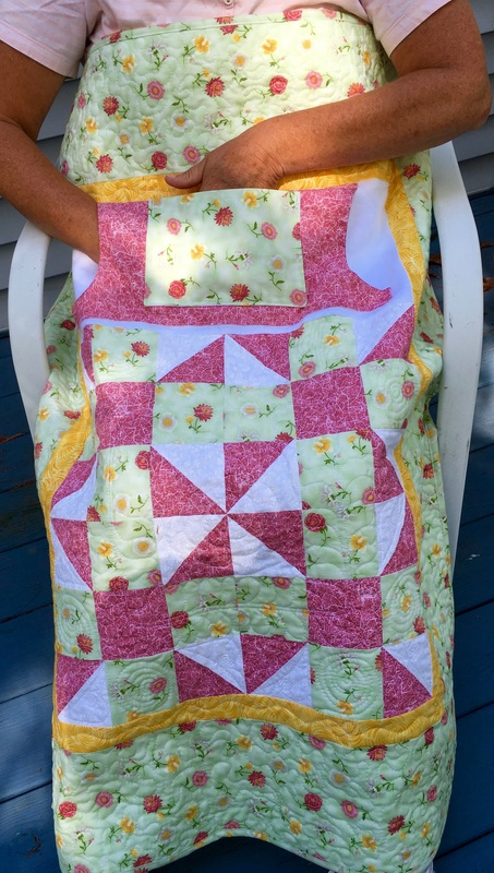 Two pocket lap quilt from http://www.HomeSewnByCarolyn.com