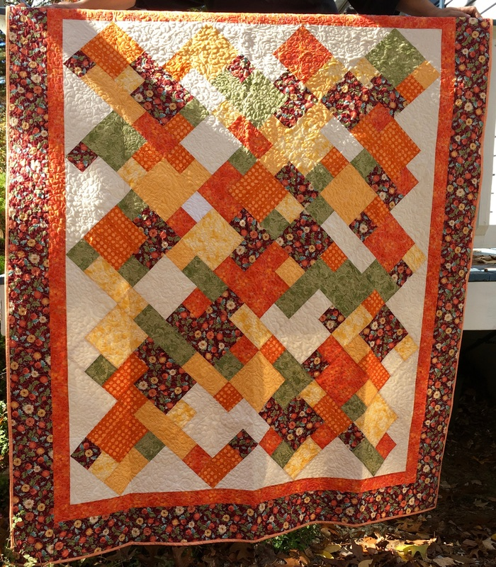 Orange and green fall quilt from http://www.HomeSewnByCarolyn.com