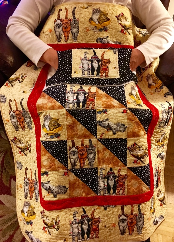Kitten Lovie Lap Quilt with Pockets to keep your hands warm from http://www.HomeSewnByCarolyn.com