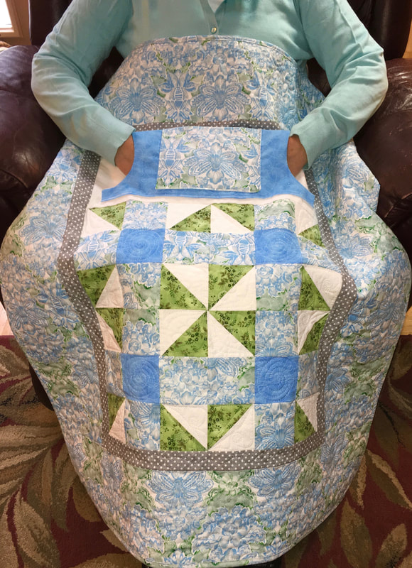Delicate Blue Lovie Lap Quilt with Pockets for sale at http://www.HomeSewnByCarolyn.com