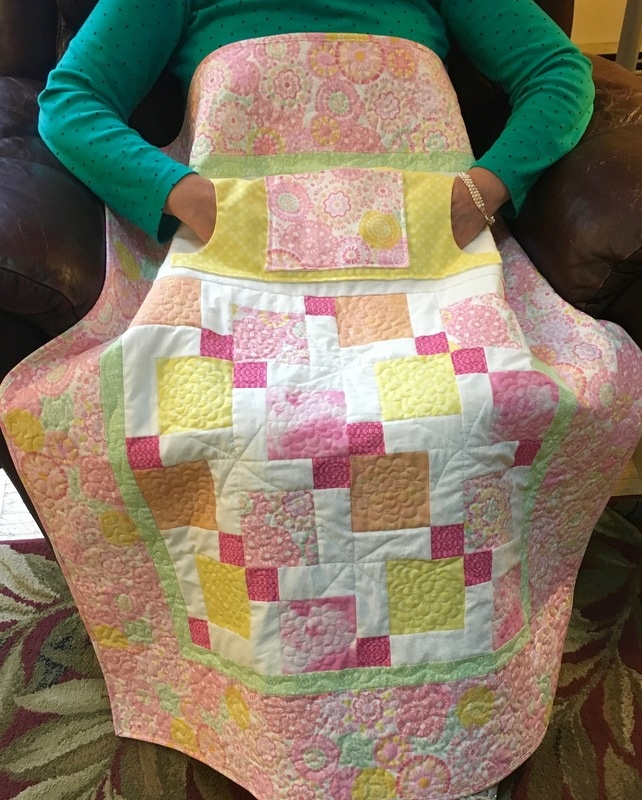 Cotton Candy Lovie Lap Quilt with Pockets from http://www.HomeSewnByCarolyn.com