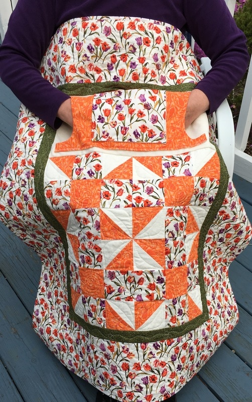 Tulip Lovie Lap Quilt with Pockets from http://www.HomeSewnByCarolyn.com.  Handmade lap quilt for sale.