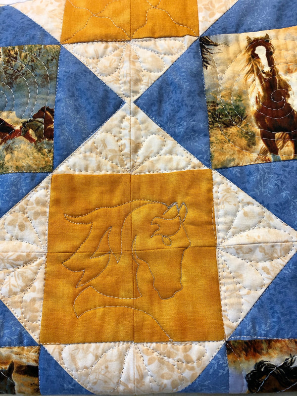 Horse free motion quilted on Lovie Lap Quilt with Pockets.