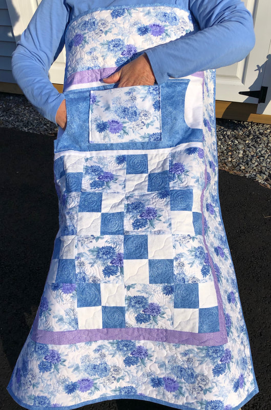 Sky Blue and Lavender Lovie Lap Quilt with Pockets for sale from http://www.HomeSewnByCarolyn.com
