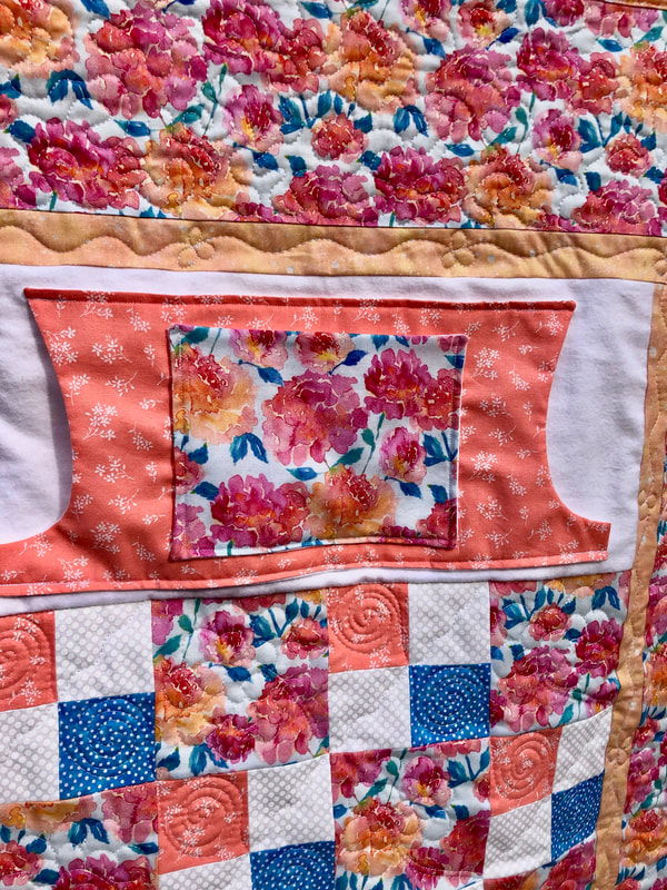 Peonies Lovie Lap quilt with pockets.