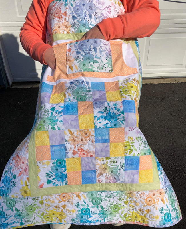 Lovie Lap Quilt with Pockets lined in flannel.