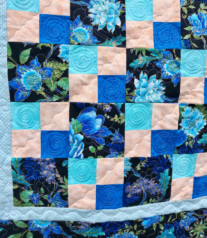 Turquoise Floral Lovie Lap Quilt with Pockets